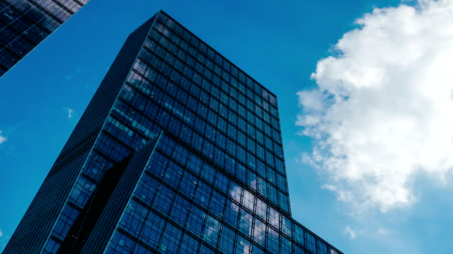 Office building and cloud reflection 4K tight shot video