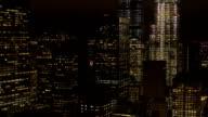 AERIAL: Office buildings & skyscrapers shining in the dark in downtown Manhattan video