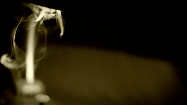 Office night scene. Cigarette/tobacco pipe smoke weaving in the desktop lamp light video