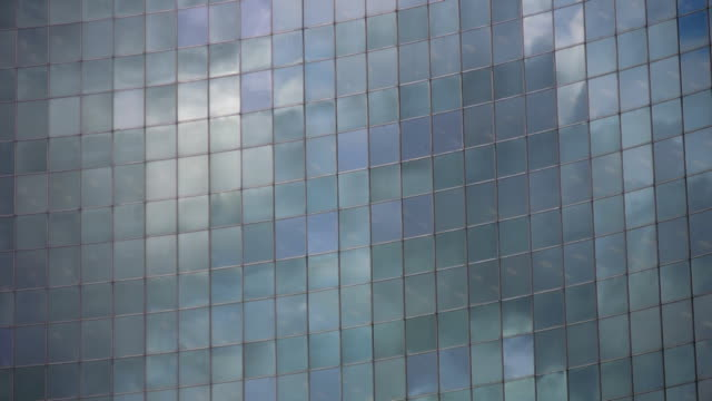 Office reflects lifting clouds. Timelapse. video