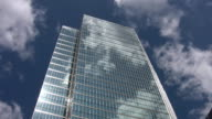 Office tower reflects clouds. Timelapse. video