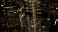 CLOSE UP Office windows on skyscrapers shining in the dark in downtown Manhattan video