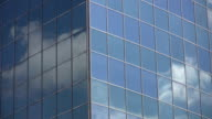 Office windows reflect clouds. Timelapse. video