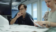 Office Workers looking Through Documents video