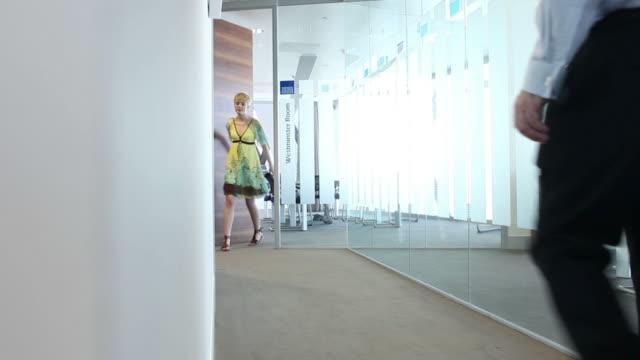 Office workers meet in hallway video
