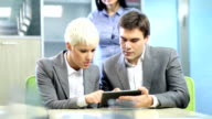 Office workers with digital tablet. video