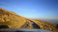 Off-road driving through Macedonian mountain peak plateau at high altitude video