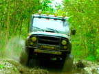 Offroad racing. Jeep driving through the wet forest video