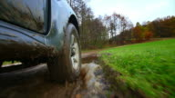 HD Off-road vehicle driving through mud POV video
