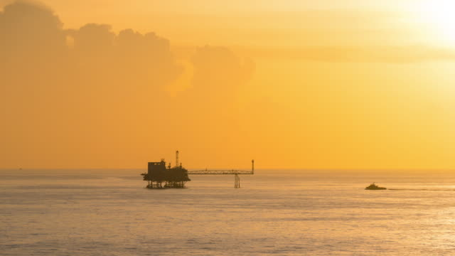 Offshore gas production platform time lapse from dusk to night video