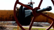 Oil and gas shut-off valve close-up. Pipeline of oil materials and natural gas. Production and processing of gasoline and other fuels. Storage station video