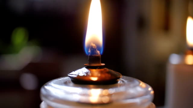 Oil candle extreme close up in church video
