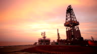 oil drill platform sailing in sunset video