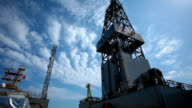 oil drill platform sailing under sky video