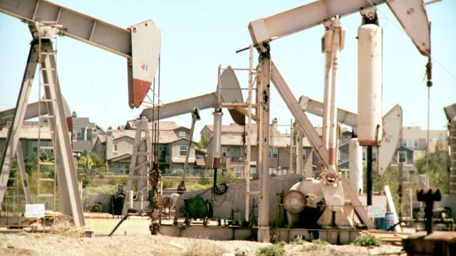 Oil drilling near family homes. Juxtaposition. video