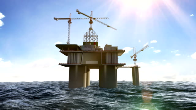 oil drilling, oil platform in the sea at daytime. video