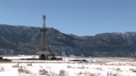 Oil drilling rig mountain close pan video