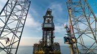 oil drilling rig with clouds time lapse day to night video