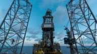 oil drilling rig with clouds time lapse morning time video