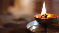 Oil lamp burning in hindu temple, India video