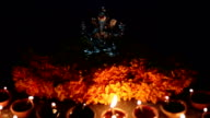 Oil lamp illuminated in front of lord ganesh, festival and religious celebration video