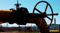 Oil pipeline stop valve. Transportation of oil products and natural gas. Pipeline at the processing plant. Gas and oil industry video