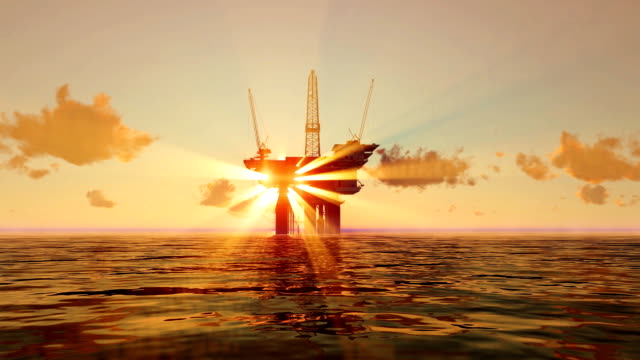 Oil platform in the sea at sunrise video