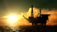 Oil platform in the sea at sunset HD loop video