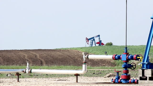oil pump jack and pipeline close up video