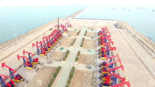 Oil pump on see in shandong,china,shoot by drone 4k video