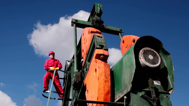 Oil Pumpjack and Worker video