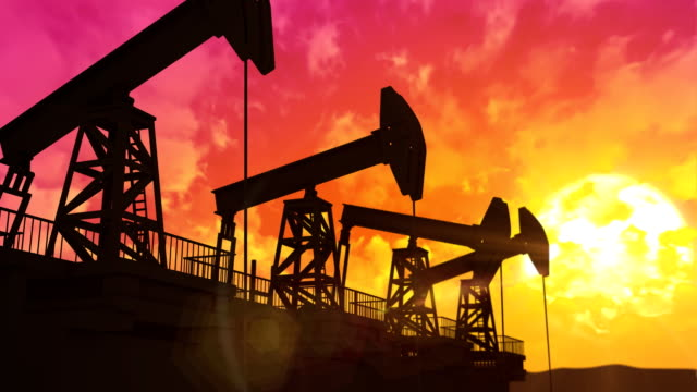 Oil pumps at sunset video
