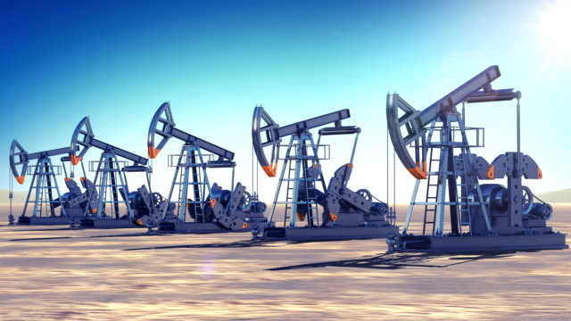 Oil Pumps at work in the desert. Sun Shining. Looped 3d animation. Business and Production Concept. video