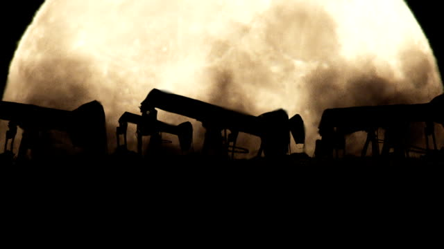 Oil Pumps on a Full Moon Background in a Polluted Environment video