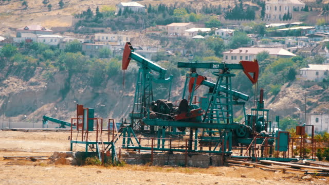 Oil Pumps, Pump jack. Fossil Fuel Energy, Old Pumping Unit video