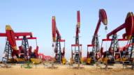 oil pumps working on oil field video
