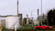 Oil Refinery And Wealthy Sports Car video