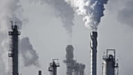 Oil refinery emitting green house gases video