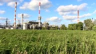 Oil refinery in sunny beautiful weather with clouds in background video