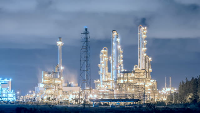 Oil refinery plant on night time , Cool tone video