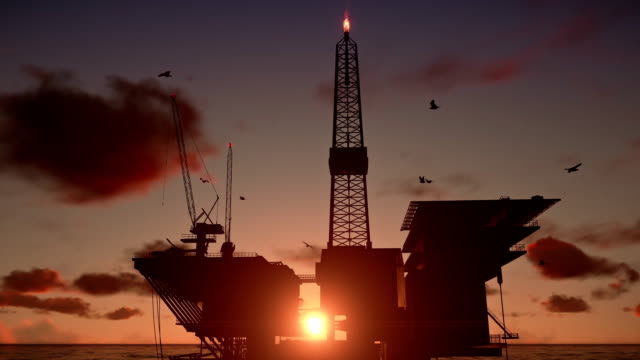 Oil Rig in ocean, close up, beautiful timelapse sunset video