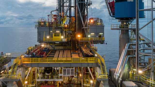 oil rig operation - day to night, time lapse video