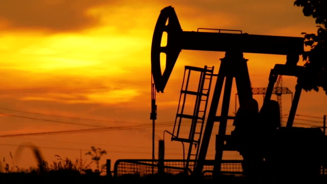 Oil rig running, sunset video