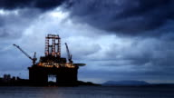 Oil rig under a stormy sky video