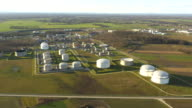 AERIAL Oil tanks with surrounding settlements video