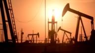 Oil wells at Sunrise video