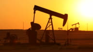 Oil Wells Pumping at Sunset video