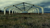 Old abandoned architectural construction at autumn field video