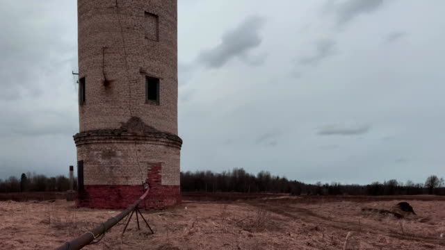 Old abandoned brick water tower timelapse video
