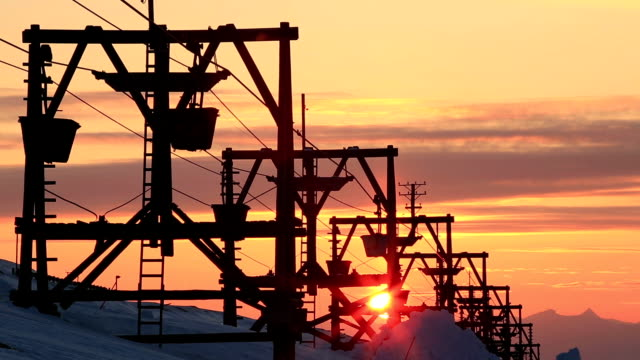 Old abandoned coal cableway in the rays of the setting sun. video